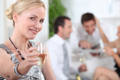 Woman toasting Royalty Free Stock Image