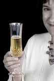 Woman toasting with champaign Royalty Free Stock Image