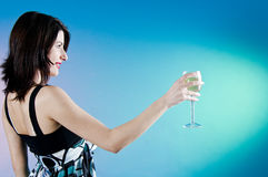 Woman toasting with a glass Royalty Free Stock Images