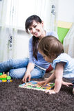 Woman with a toddler Stock Images