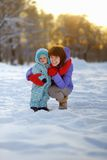 Woman with toddler boy at the winter park Royalty Free Stock Photos
