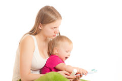 Woman and toddler girl brushing tooth Royalty Free Stock Photos
