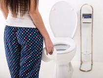 Woman in toilet. Close-up of woman on toilet in morning Royalty Free Stock Images