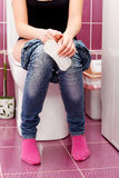 Woman in a toilet Stock Photography