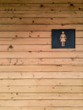 Woman toilet sign on wooden. Background Stock Photography