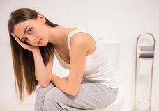 Woman in toilet Stock Photography