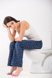 Woman in toilet Stock Photo