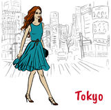 Woman in Tokyo. Woman with shopping bags walking on street in Shibuya, Tokyo, Japan Royalty Free Stock Images
