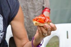 Woman with tomato bruschetta Stock Photo