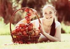 Woman with tomato harvest in garden Stock Photo