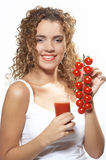 Woman with tomato juice. Photo N3. Half body portrait of young woman holding glass of tomato juice and tomatoes on vine, isolated on white background Stock Photography