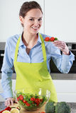 Woman with tomato salad Stock Images