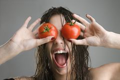 Woman with tomatoes over eyes. Stock Image