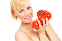 Woman with tomatoes Stock Image
