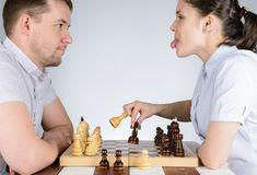 Woman tongue out an opponent in chess Royalty Free Stock Image