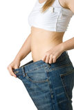 Woman in too big jeans. On white isolated background Stock Photos