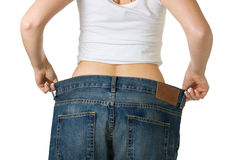 Woman in too big jeans Royalty Free Stock Photos