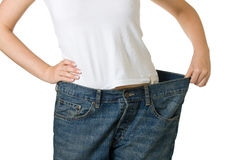 Woman in too big jeans Stock Photo