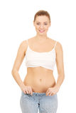 Woman in too big pants. Royalty Free Stock Photography