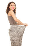 Woman in too great camouflage trousers Royalty Free Stock Images