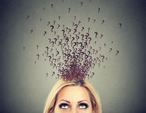 Woman with too many questions and no answer. Headshot of a woman with too many questions and no answer Stock Image