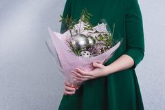 The woman took a bouquet of flowers and kitchen utensils. concept of sexism, feminism and patriarchal society and gender. Inequality royalty free stock photo