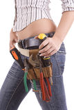 Woman with tool bag Royalty Free Stock Image