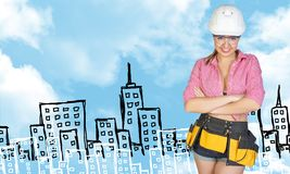 Woman in tool belt and helmet. Sketch buildings as Royalty Free Stock Image
