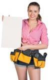 Woman in tool belt holding ceramic tile Stock Photo
