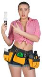 Woman in tool belt holding energy-saving lamp Royalty Free Stock Images