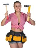 Woman in tool belt holding hammer and angle ruler Royalty Free Stock Photo