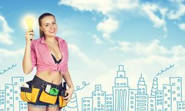 Woman in tool belt holding light bulb. Sketch Royalty Free Stock Photography