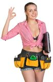 Woman in tool belt, with laptop under her armpit Stock Images