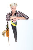 Woman with a tool belt Stock Photo