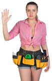 Woman in tool belt showing empty hand Stock Image