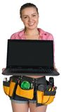 Woman in tool belt showing opened laptop with Royalty Free Stock Image