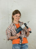 Woman with tool Royalty Free Stock Images
