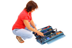 Woman on the tool box. Isolated Royalty Free Stock Photography