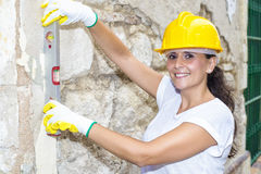 Woman with tool level Royalty Free Stock Image