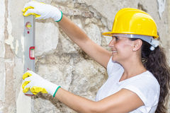 Woman with tool level Stock Image