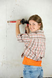 Woman with tool Royalty Free Stock Photo