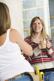 Woman With Toolbelt Talking To Smiling Female stock images
