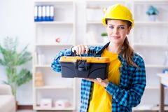 The woman with toolkit in workshop. Woman with toolkit in workshop Stock Photography