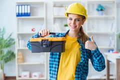The woman with toolkit in workshop. Woman with toolkit in workshop Stock Images