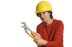 Woman with tools. Woman middle age with tools wearing safety helmet smiling home renovation stock photography