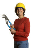 Woman with tools. Woman middle age with tools wearing safety helmet smiling home renovation royalty free stock photography
