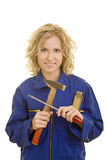 Woman with tools. Young woman in a blue overall with tools in her hand royalty free stock photo