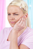 Woman with tooth ache. Holding hands on her cheek Royalty Free Stock Images