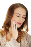 Woman with tooth ache. Woman suffering from tooth ache Royalty Free Stock Photography
