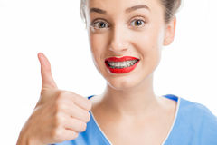 Woman with tooth braces royalty free stock image